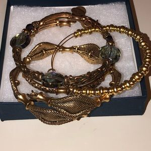 4 gold tone Alex and Ani bangles